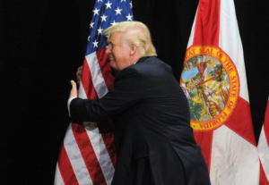 Trump hugs flag